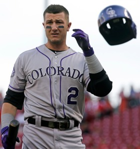 Colorado Rockies' Troy Tulowitzki tosses his helmet after striking out against Cincinnati Reds starting pitcher Homer Bailey in the first inning of a baseball game, Tuesday, June 4, 2013, in Cincinnati. (AP Photo/Al Behrman)
