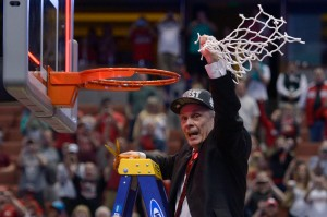 Mar 29, 2014; Anaheim, CA, USA; Wisconsin Badgers head coach Bo Ryan celebrates by cutting the net after overtime in the finals of the west regional of the 2014 NCAA Mens Basketball Championship tournament against the Arizona Wildcats at Honda Center. The Badgers defeated the Wildcats 64-63. Mandatory Credit: Robert Hanashiro-USA TODAY Sports