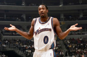 WAHINGTON - DECEMBER 15: Gilbert Arenas #0 of the Washington Wizards questions a call with the ref as they host the Miami Heat during NBA action on December 15, 2004 at the MCI Center in Washington, DC. NOTE TO USER: User expressly acknowledges and agrees that, by downloading and or using this photograph, User is consenting to the terms and conditions of the Getty Images License Agreement. (Photo by Doug Pensinger/Getty Images)